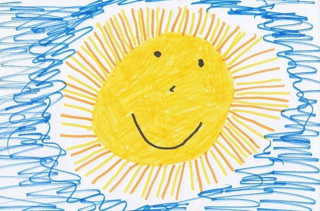 Konderzeichnung einer lächelnden Sonne